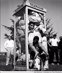 Photograph by Joe Munroe in LIFE Magazine, 1959, Saint Mary's College of California. 22 students vie for world record in phone booth occupancy. Photo: Joe Munroe